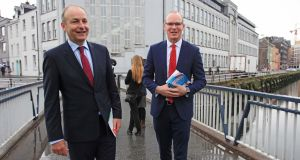 Tánaiste Simon Coveney and leader of Fianna Fáil Micheál Martin as they both canvassed in Cork city on Monday morning. Photograph: Diane Cusack