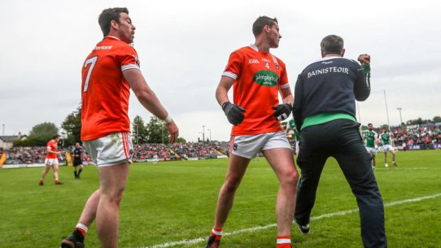 Fermanagh manager Rory Gallagher celebrates next to Armagh's Aidan Forker and Aaron McKay. Photograph: James Crombie/Inpho