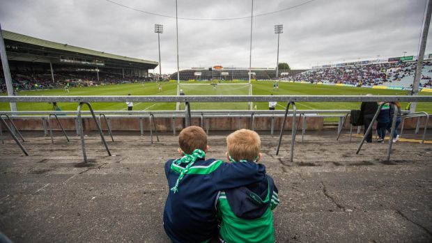 Limerick fans Jonathan and Jamie Byrne watch the minor game ahead of their side's win over Tipperary. Photograph: Tommy Dickson/Inpho
