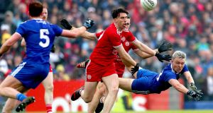 Tyrone's Conall McCann in action against Monaghan's Conor McCarthy at Healy Park. Photograph: James Crombie/Inpho