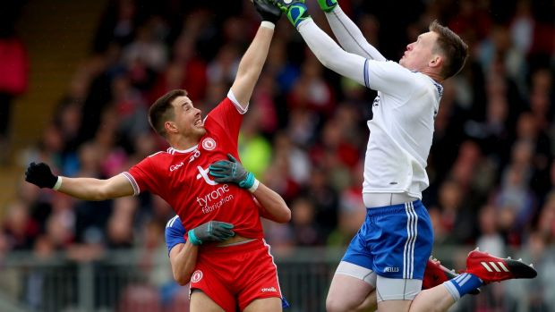 Monaghan's Rory Beggan claims the ball ahead of Tyrone's Ronan O'Neill at Healy Park. Photograph: James Crombie/Inpho