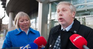 Paul Richardson and his wife Marie speaking to media outside Dublin Circuit Criminal Court  in January 2014 after an earlier verdict in relation to their family being held hostage. File photograph: Collins Courts