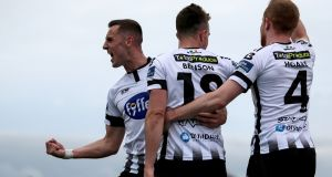 Robbie Benson celebrates Dundalk's opener against Waterford. Photograph: Laszlo Geczo/Inpho