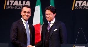 5-Star Movement leader Di Maio shakes hands with Giuseppe Conte in Rome in March. Conte, a little-known law professor, has been put forward as prime minister to lead the coalition. Photograph: Remo Casilli/Reuters