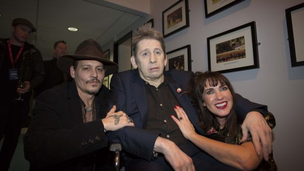 Johnny Depp with Shane MacGowan and Victoria Mary Clarke at MacGowan's 60th Birthday Celebration in the National Concert Hall, Dublin, in January. Photograph: Tom Honan/The Irish Times
