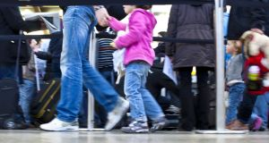 Allgaeu airport in Memmingen: passengers with children await check-in or departure. Photograph:  EyesWideOpen/Getty