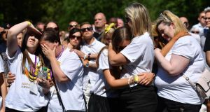 People hug as they observe a minute's silence at the outside broadcast of the Manchester Arena national service of commemoration at Manchester Cathedral on Tuesday. Photograph:  Leon Neal/Getty Images