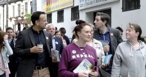 Taoiseach Leo Varadkar canvassing for a Yes vote in Tullamore, Co Offaly, with Minister for Health Simon Harris. Photograph: Kathleen Harris