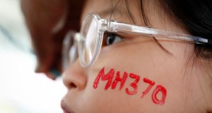 A girl is pictured during the Day of Remembrance for MH370 event in March, in Kuala Lumpur, Malaysia. File photograph: AP Photo/Vincent Thian