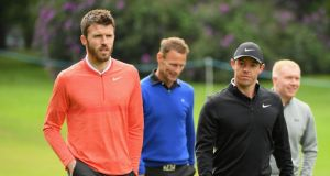 Rory McIlroy  walks with former Manchester players Michael Carrick,  Teddy Sheringham and Paul Scholes during the Pro-Am for the BMW PGA Championship at Wentworth. Photograph: Ross Kinnaird/Getty Images