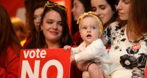 Charmaine Van Maren, with her daughter Charlotte, joined supporters at the Save the 8th campaign's final press conference in Dublin. Photograph: Dara Mac Dónaill