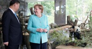 Chinese president Xi Jinping and German chancellor Angela Merkel at  the Zoo in Berlin in July 2017. Photograph: Axel Schmidt/Reuters