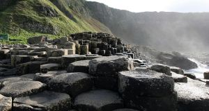 Giant's Causeway: In the company of 37,000 mostly hexagonal columns that were created by rapidly cooling lava 60 million years ago, I sit and absorb the otherworldliness of it all. Photograph: Paul Faith/PA Wire