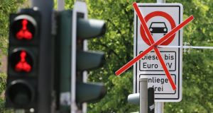 A Hamburg road sign  indicates a  ban for older diesel cars and trucks. Photograph: EPA