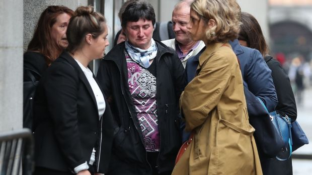 Catherine Devallonne, the mother of murdered French au-pair Sophie Lionnet, and her husband Stephane Devallonne, arrive at London's Central Criminal Court. Photograph: Daniel Leal-Olivas/AFP/Getty Images