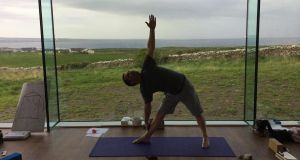 Hatha yoga: aims to balance two energies through postures and breathing