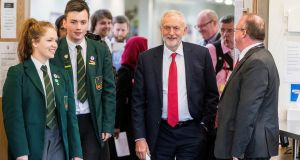 Labour leader Jeremy Corbyn with head girl Lucy Symington (left) and head boy Michael Hare (second left) walking into the library at Lagan College, Northern Ireland's first integrated school, during Mr Corbyn's first visit to Northern Ireland as party leader. Photograph: Liam McBurney/PA Wire