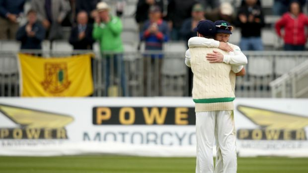 Ed Joyce hugs Stuart Thompson at the end of the Test match against Pakistan in Malahide. Photograph: Oisín Keniry/Inpho
