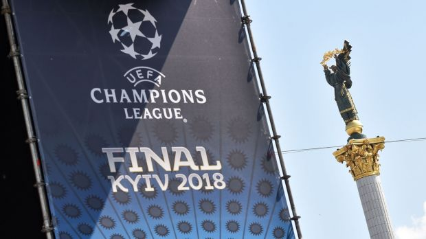 A placard bearing the logo of the Uefa Champions League Cup final is displayed at the fan zone in Kiev. Photograph: Sergei Supinsky/AFP/Getty Images