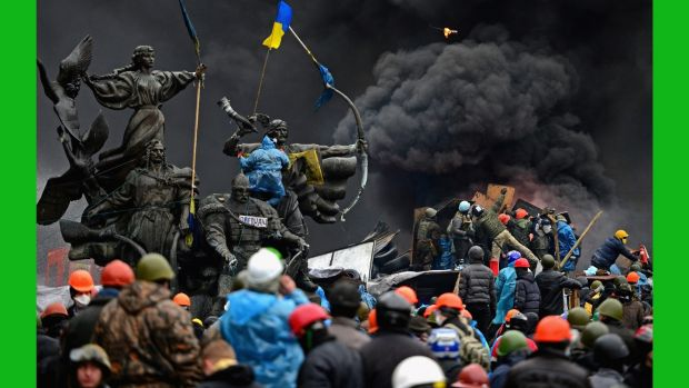 Anti-government protesters clash with police in Independence square in February 2014. More than 100 protestors and 18 police officers were killed during the Maidan protests. Photograph: Jeff J Mitchell/Getty Images