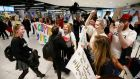 Welcome parties greet emigrants home to vote at Dublin Airport