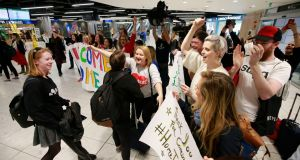 Campaigners for a Yes vote in the abortion referendum welcome supporters rriving at Dublin Airport  on Thursday evening. Photograph: Nick Bradshaw