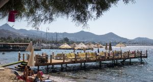 Enjoying the sun at Bodrum, Turkey. The slump in theTurkish Lira is proving a boon for euro zone tourists. Photograph:  Chris McGrath/Getty Images
