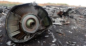 Part of the Malaysia Airlines Flight MH17 at the crash site in the village of Hrabove (Grabovo), some 80km east of Donetsk in Ukraine, in September 2014. Photograph: Alexander Khudoteply/AFP/Getty Images
