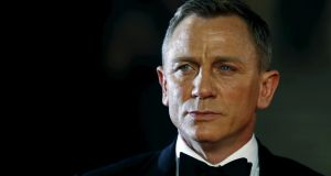 Daniel Craig poses for photographers as he attends the October 2015 world premiere at the Royal Albert Hall,  London of Spectre, his previous film as James Bond. Photograph: Luke MacGregor/Reuters