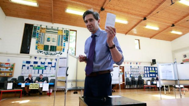 Minister for Health Simon Harris votes at his local polling station in Delgany, Co Wicklow. Photograph: Nick Bradshaw