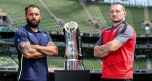 Leinster's Isa Nacewa and Scarlets's Ken Owens  pose with the Pro14 trophy ar Aviva Stadium ahead of the final. Photograph: Dan Sheridan/Inpho