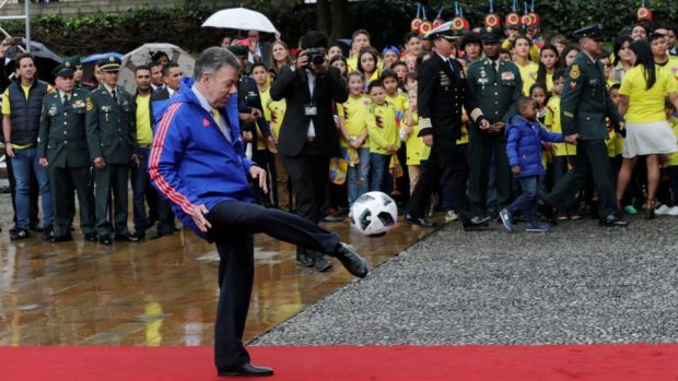 Colombia's outgoing president Juan Manuel Santos during a ceremony handing the Colombian flag to the national soccer team's captain prior to its participation in the World Cup in Russia, in Bogota. Photograph: Henry Romero