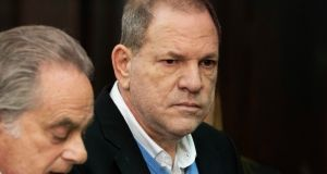 Harvey Weinstein (right), stands with his attorney Benjamin Brafman during a court proceeding in New York on Friday. Weinstein was arraigned  on rape and other charges in the first criminal prosecution to result from the wave of allegations against him that sparked a national reckoning over sexual misconduct. Photograph: Steven Hirsch/New York Post via AP