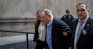A handcuffed Harvey Weinstein is led into criminal court in lower Manhattan for arraignment on Friday morning, May 25, 2018. Weinstein was arrested by detectives on Friday on charges that he raped one woman and forced another to perform oral sex, capping a lengthy inquiry into the avalanche of accusations against him that spawned a public reckoning, and, with it, the global #MeToo movement. (Hilary Swift/The New York Times) Rape charge: a handcuffed Harvey Weinstein is led into criminal court in lower Manhattan on Friday morning. Photograph: Hilary Swift/New York Times