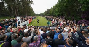 Huge crowds surround the 12th tee as Rory McIlroy drives  during the second round of the BMW PGA Championship at Wentworth. Photograph:  Richard Heathcote/Getty Images