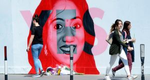 VOTE YES Floral tributes to Savita Halappanavar, who died of septicaemia after being refused an abortion, in 2012, left at her mural at the George Bernard Shaw pub in Dublin. Photograph:  Cyril Byrne