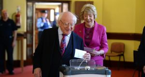 President Michael D Higgins and his wife Sabina casting their votes in the referendum on the Eighth Amendment at St Mary's Hospital in the Phoenix Park. Photograph: Cyril Byrne