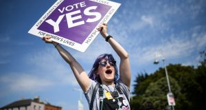 A member of the public holding a Yes placard in Fairview, Dublin as Ireland voted in the abortion referendum. Photograph: Jeff J Mitchell/Getty