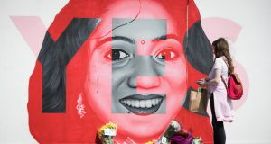 Lucy Cooper from Cavan standing at a mural of Savita Halappanavar in Dublin on Friday. Photograph: Tom Honan/The Irish Times