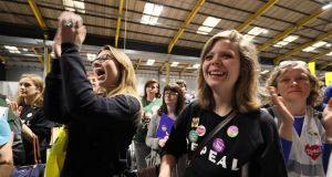 Repeal supporters at Dublin's RDS wait for the start of the count. Photograph: Brian Lawless/PA Wire