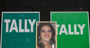 A tally sign featuring a photo of Savita Halappanavar during the abortion referendum count in the RDS, Dublin. Photograph: Gareth Chaney/Collins