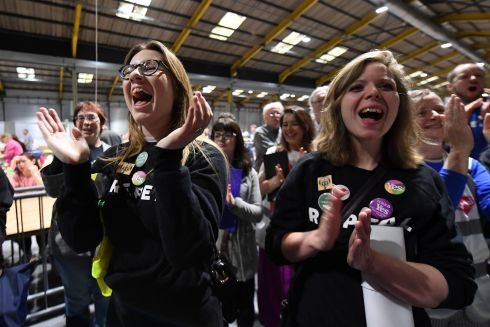 People listen to results of an exit poll as counting of the votes began. Photograph: Clodagh Kilcoyne/Reuters