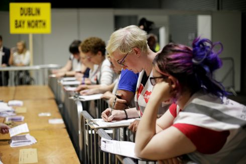 Observers watch as votes are tallied in Dublin on Saturday. Photograph: Max Rossi/Reuters