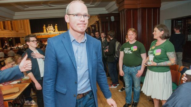 Tánaiste Simon Coveney with Together for Yes activists at the referendum count for Cork city on Saturday. Photograph: Daragh Mc Sweeney/Provision