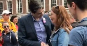 Yes supporter Laura Mahon and Minister for Health Simon Harris share an emotional moment in Dublin Castle. Photograph: @Niamh_Cupl/Twitter