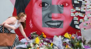 Floral tributes are laid  at a mural to Savita Halappanavar on  Camden Street in Dublin on Saturday. Photograph: Getty Images