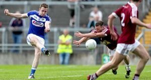 Laois' Paul Kingston scores one of his three goals  despite an attempted block from Westmeath's  Alan Stone during the Leinster SFC quarter-final at  Bord na Mona O'Connor Park in Tullamore. Photograph: Laszlo Geczo/Inpho