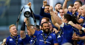 Leinster captain  Isa Nacewa lifts the  Guinness pro 14 trophy after the victory over Scarlets at the Aviva Stadium. Photograph: James Crombie/Inpho