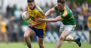 Roscommon's Cathal Cregg with Alan Armstrong of Leitrim. Photograph: Tommy Grealy/Inpho