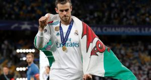 Real Madrid's Gareth Bale celebrates with a Wales flag and his medal in Kiev. Photograph: Andrew Boyers/Reuters